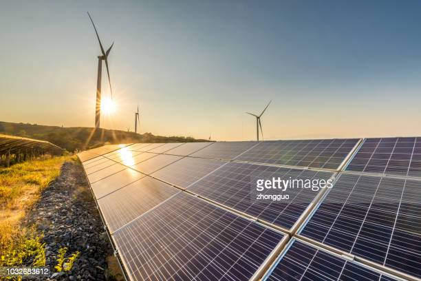solar energy and wind power stations - power line stock pictures, royalty-free photos & images