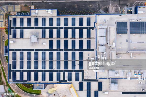 solar energy panel on the rooftop - liyao xie stock pictures, royalty-free photos & images