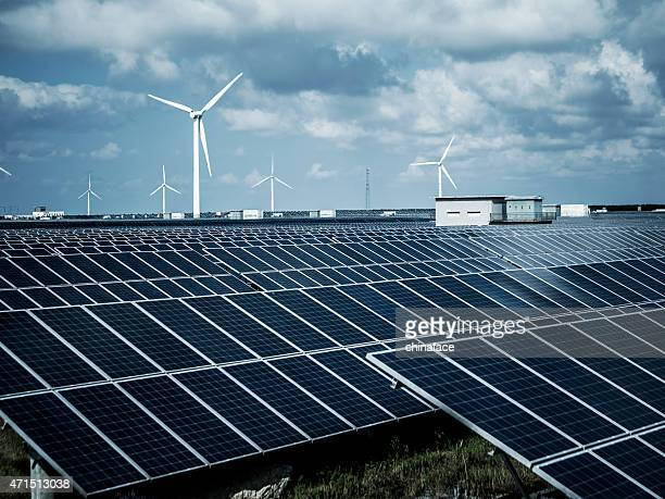 solar energy panels and wind turbines - power in nature stock pictures, royalty-free photos & images