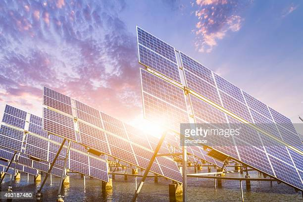 solar energy panels and wind turbines - science and technology stock pictures, royalty-free photos & images