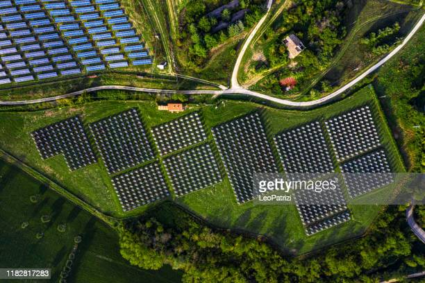 solar energy station in countryside aerial view - renewable energy stock pictures, royalty-free photos & images