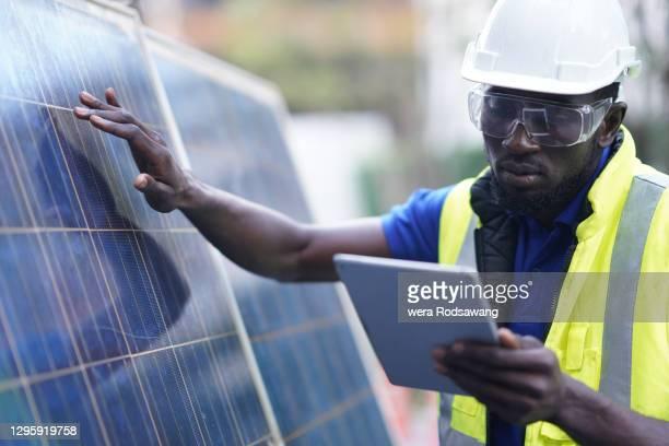 solar energy systems engineer perform analysis solar panels - fornecimento de energia imagens e fotografias de stock