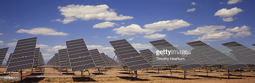 Solar farm with blue sky and clouds : Stock Photo