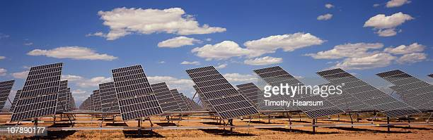 solar farm with blue sky and clouds - timothy hearsum ストックフォトと画像