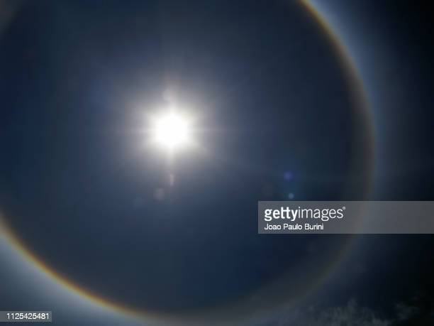 solar halo, also known as sundog - angel halo stock pictures, royalty-free photos & images