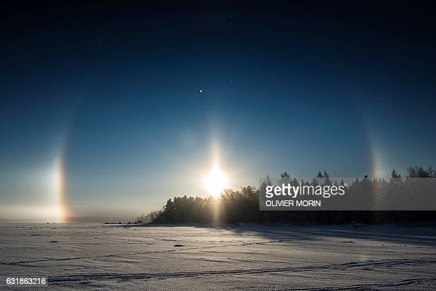 TOPSHOT A solar halo is pictured over the frozen sea in Vaasa by 15°C on January 15 2017 The Halo is an optical phenomena produced by light...
