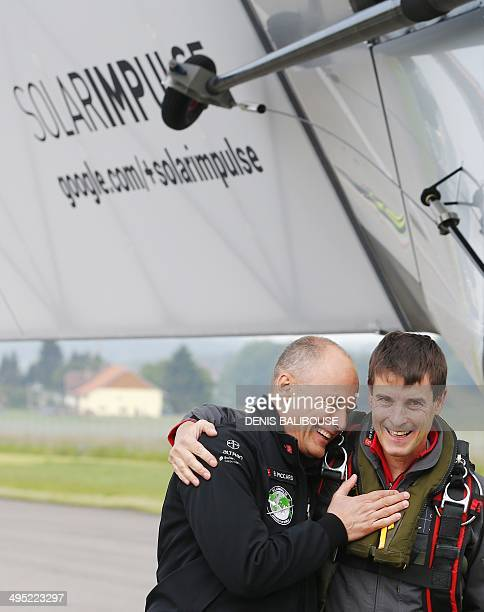 Solar Impulse cofounder Bertrand Piccard congratulates German test pilot Markus Scherdel after its maiden flight with the solarpowered Solar Impulse...