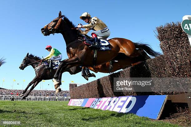 Solar Impulse ridden by Sam TwistonDavies alongside Sizing Granite ridden by Johnny Burke clear the last fence in the The Doom Bar Maghull Novices...