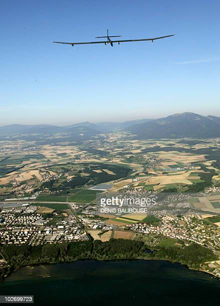 Solar Impulse's Chief Executive Officer and pilot Andre Borschberg flies over the Neuchatel lake in the solarpowered HBSIA prototype airplane after...