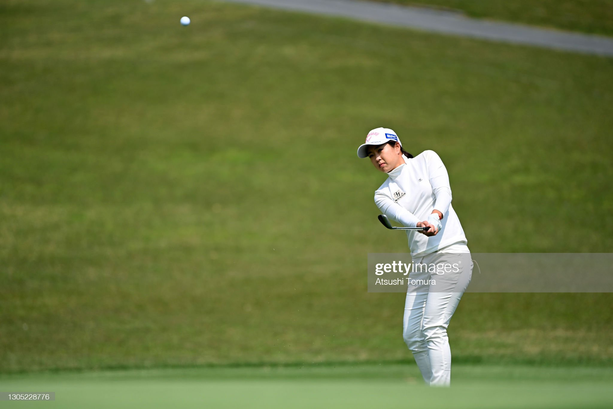 https://media.gettyimages.com/photos/solar-lee-of-south-korea-chips-onto-the-13th-green-during-the-first-picture-id1305228776?s=2048x2048