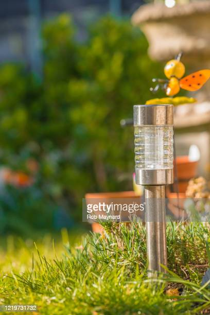 solar light at the garden - lighting equipment stock pictures, royalty-free photos & images