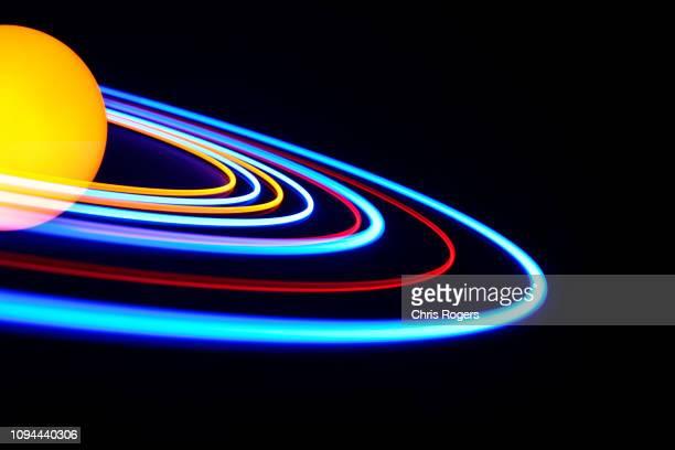 solar orbs - orbiting fotografías e imágenes de stock