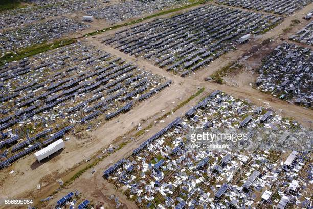Solar panel debris is seen scattered in a solar panel field in the aftermath of Hurricane Maria in Humacao Puerto Rico on October 2 2017 President...