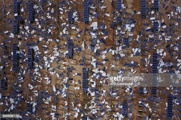 Solar panel debris is seen scattered in a solar panel field in the aftermath of Hurricane Maria in Humacao, Puerto Rico on October 2, 2017. President...