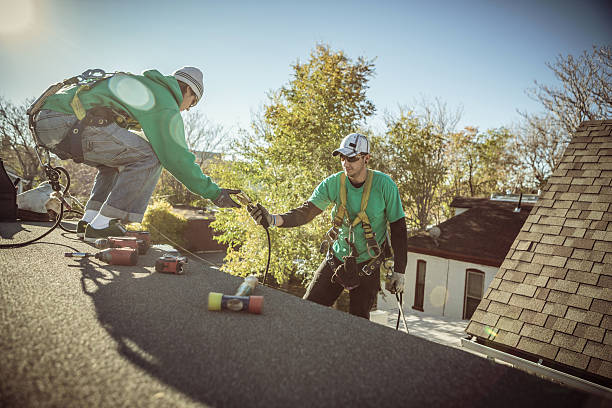 Solar panel installation crew members on roof of house