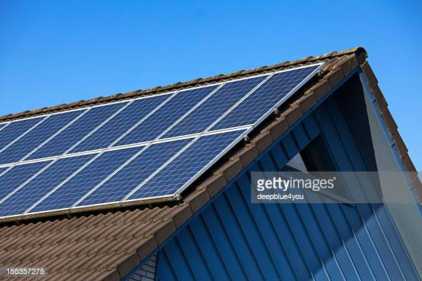 solar panel on gable roof against blue sky - solar powered station stock pictures, royalty-free photos & images