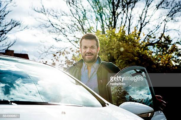 solar panel salesman by his car - heshphoto stock pictures, royalty-free photos & images