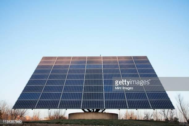 solar panels against blue sky - steuerpult stock-fotos und bilder