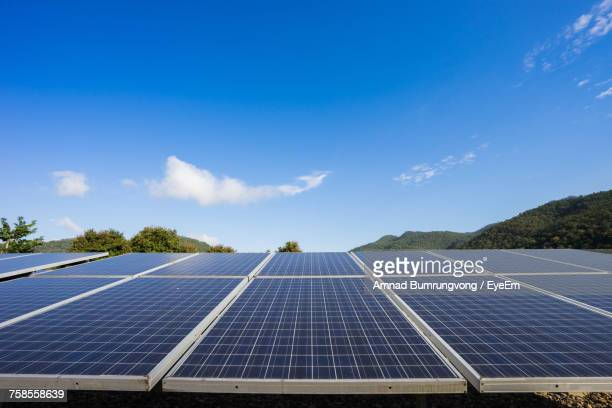 solar panels against blue sky - energy efficient stock photos and pictures