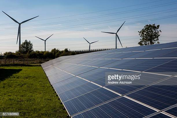 Solar panels and wind turbines at the Solar array of community project Low carbon Gordano a community renewable energy project Delivering 1750HWh per...