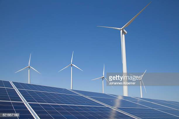 solar panels and wind turbines - 風力発電 ストックフォトと画像