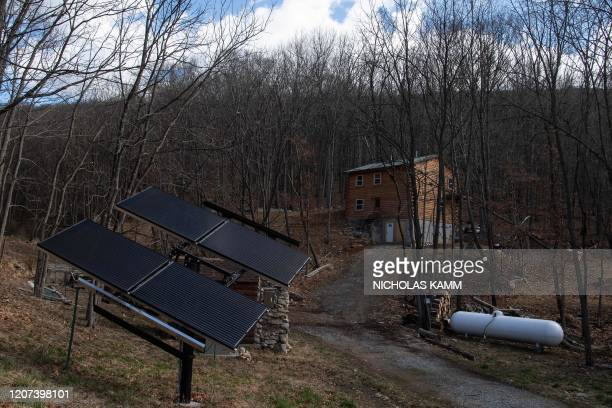 Solar panels are seen at the Fortitude Ranch in Mathias West Virginia on March 13 2020 The narrow worn track in West Virginia close to the foothills...