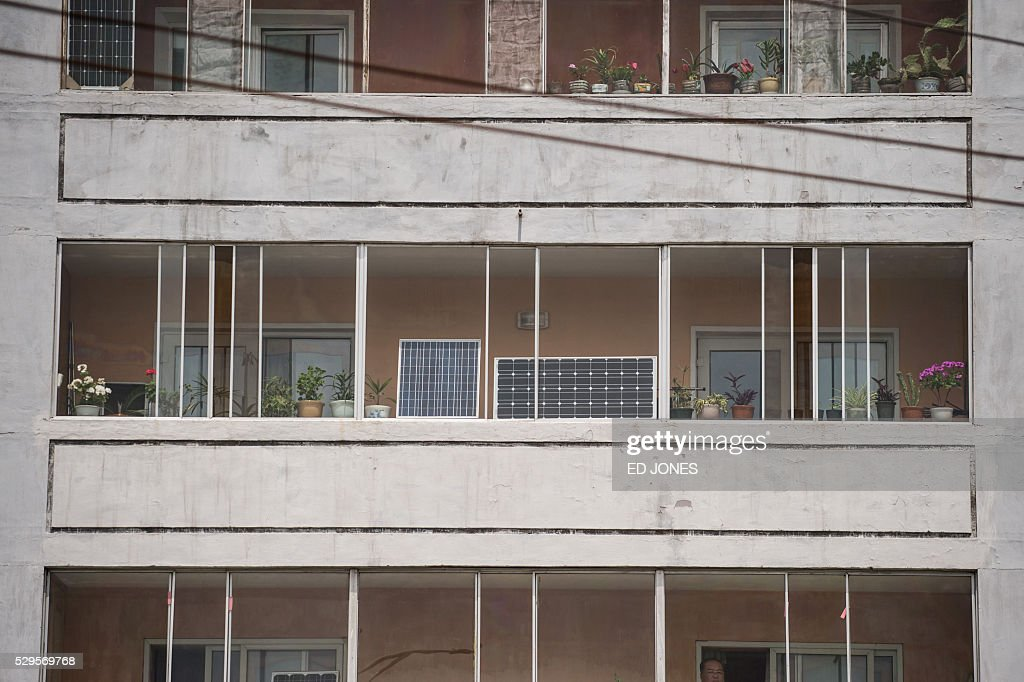 Solar panels are seen on a balcony in Pyongyang on May 9, 2016. / AFP / Ed Jones