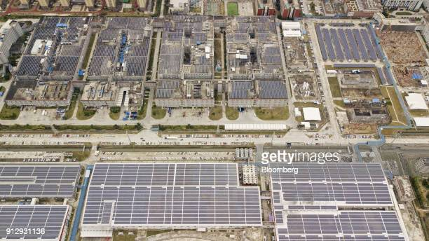 Solar panels are seen on rooftops at the Contemporary Amperex Technology Ltd headquarters and manufacturing complex in this aerial photograph taken...