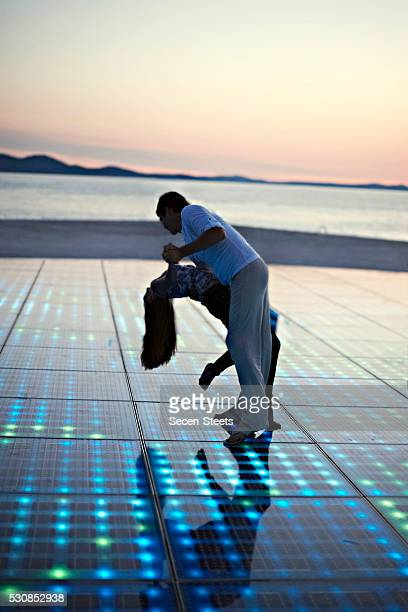Solar panels as a dance floor, sunset in background