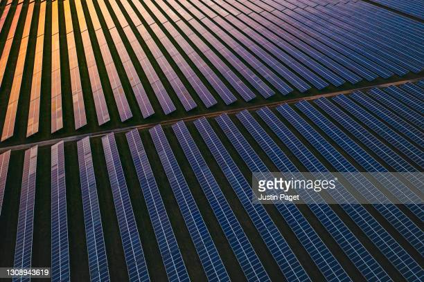 solar panels at dusk - elevated view stock pictures, royalty-free photos & images