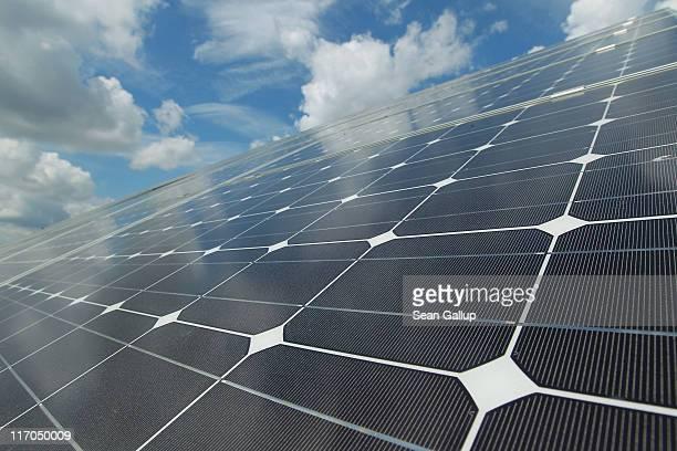 Solar panels belonging to German alternative energy producer Energiequelle GmbH stand oriented towards the sun on June 20 2011 near Feldheim Germany...