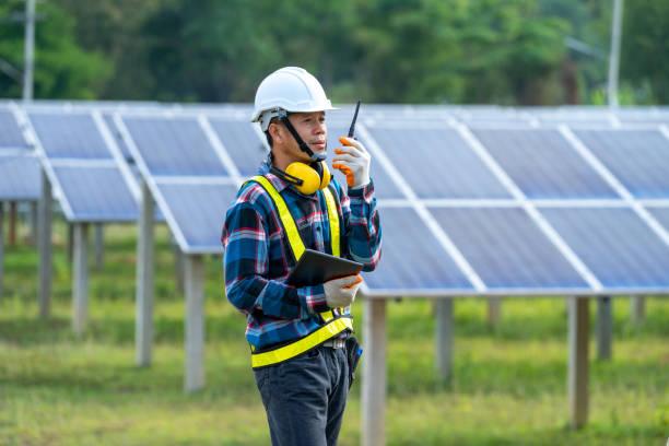 Solar panels engineer working at solar panels field.