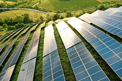 Solar panels fields on the green hills 1170098138