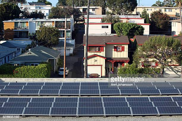 Solar panels generating energy for a condominium complex stand on a parking garage roof in Santa Monica May 29 2012