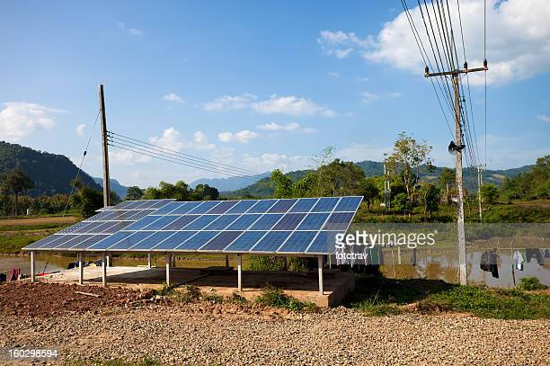 Solar panels in a backyard in rural Laos