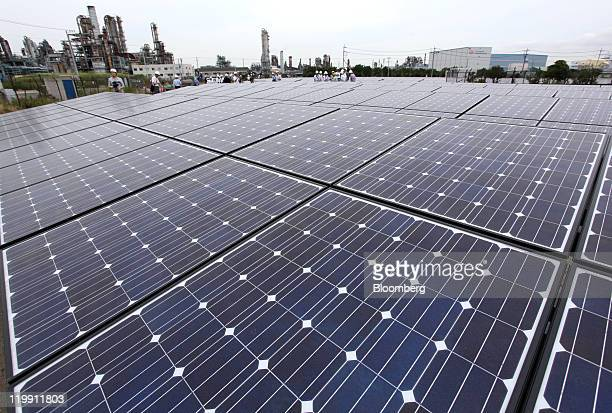 Solar panels manufactured by Sharp Corp sit at the Ukishima Solar Power Plant in Kawasaki City Kanagawa Prefecture Japan on Wednesday July 27 2011...
