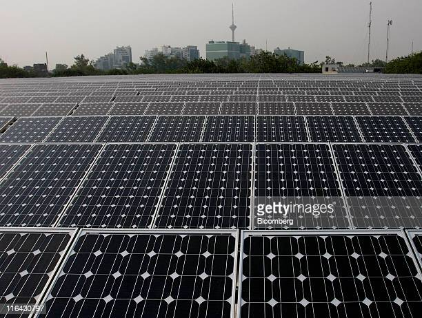 Solar panels manufactured by Tata BP Solar India Ltd stand at North Delhi Power Ltd's Keshavpuram power station in New Delhi India on Tuesday June 14...