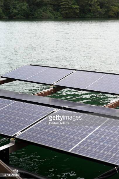 solar panels on a floating platform of a fish farm - sea pen stock pictures, royalty-free photos & images