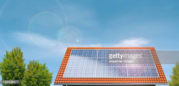 Solar Panels on a house roof under blue sky