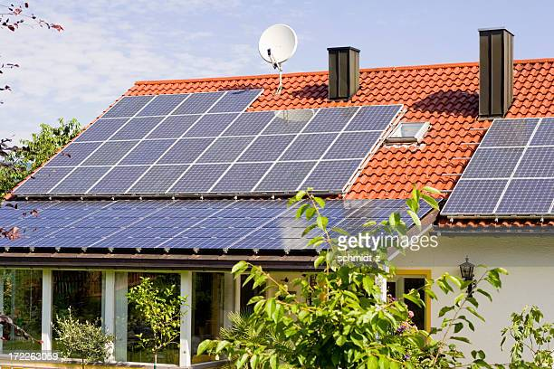 solar panels on a house rooftop - solar energy dish stock pictures, royalty-free photos & images
