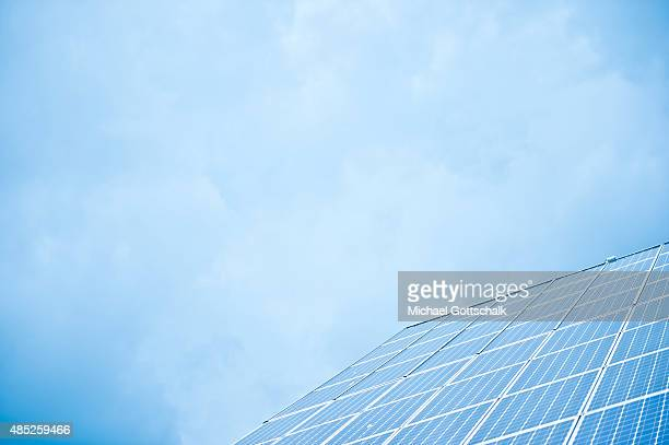 Solar panels on a roof of a house with blue sky in the background on August 25 2015 in Berlin Germany