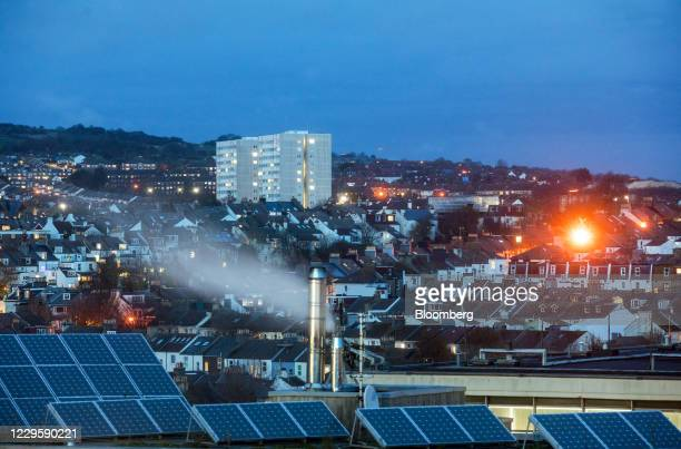 Solar panels on a rooftop against a backdrop of residential housing at dusk in Brighton, U.K., on Wednesday, Nov. 11, 2020. Brexit talks are going...