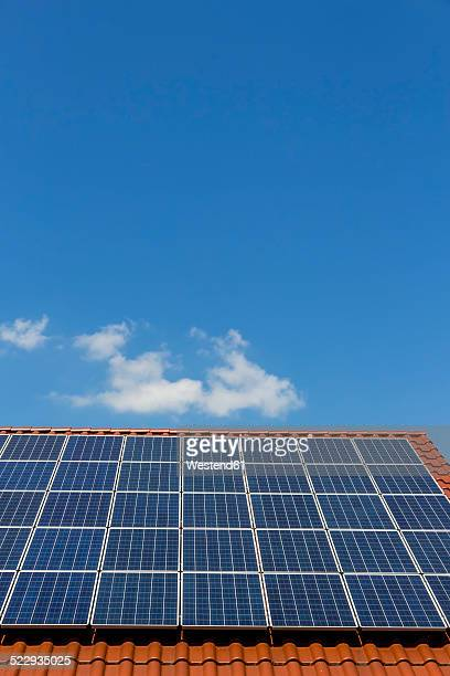 Solar panels on a rooftop, partial view