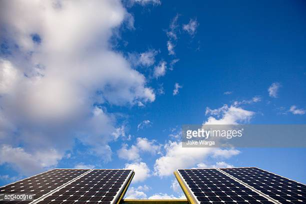 solar panels on a sunny day - jake warga stock photos and pictures
