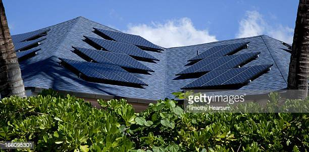 solar panels on home rooftop - timothy hearsum stock pictures, royalty-free photos & images