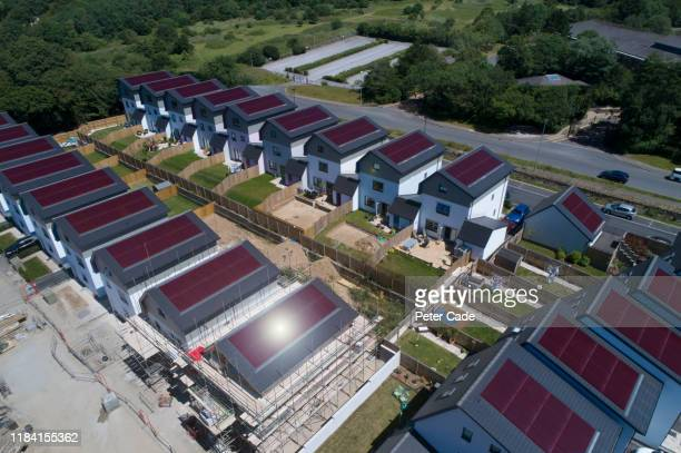 solar panels on new build houses - housing development stock pictures, royalty-free photos & images