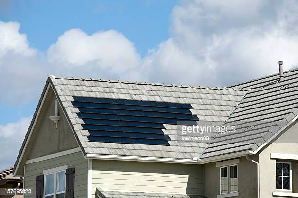 solar panels on roof - solar energy dish stock pictures, royalty-free photos & images