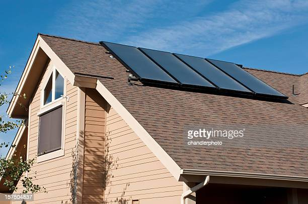 solar panels on the rooftop of a home - solar mirror stock pictures, royalty-free photos & images