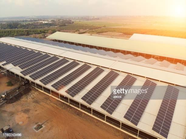 solar panels renewable energy aerial view - solar powered station stock pictures, royalty-free photos & images