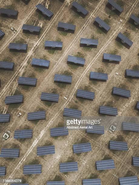 solar panels shot by drone, spain - aragon fotografías e imágenes de stock